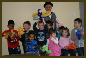 The happy recipients of The Party Magician's balloon creations